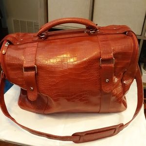 Bath & Body Works red textured travel bag